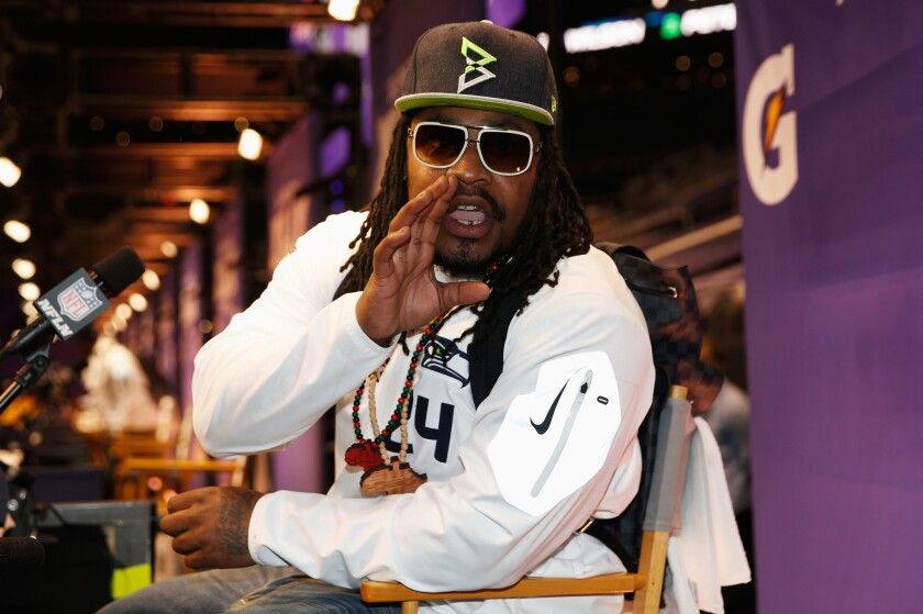 Seattle running back Marshawn Lynch takes part in a media session leading up to Super Bowl XLIX.