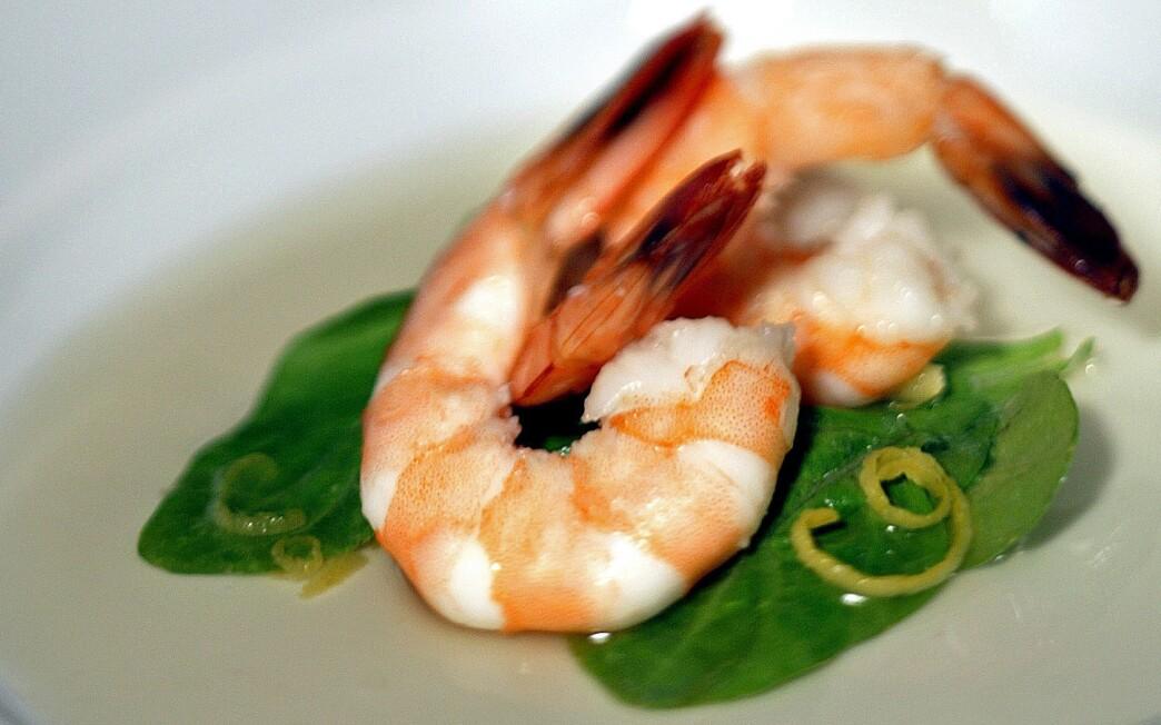 Consomme with shrimp, arugula and lemon zest