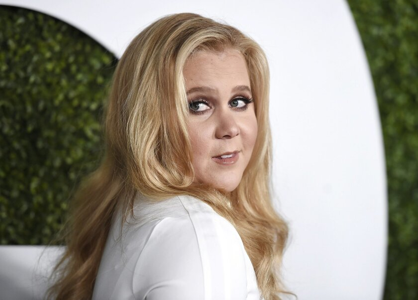FILE - In this Dec. 3, 2015, file photo, Amy Schumer arrives at the GQ Men of the Year Party at the Chateau Marmont in Los Angeles. Schumer fired back at critics of her looks on social media May 24, 2016. (Photo by Jordan Strauss/Invision/AP, File)