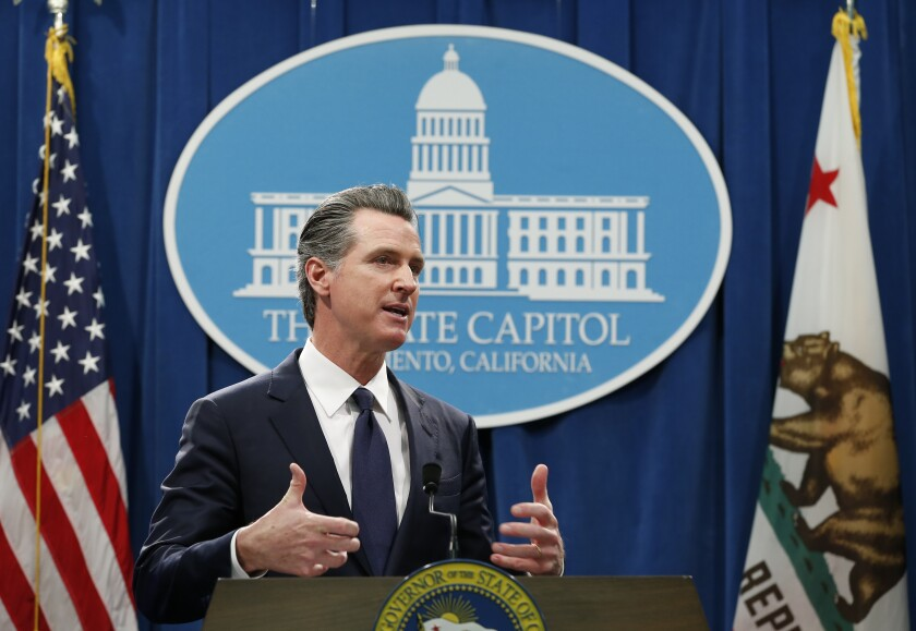California Gov. Gavin Newsom discusses his proposed 2020-2021 state budget during a news conference in Sacramento on Friday.