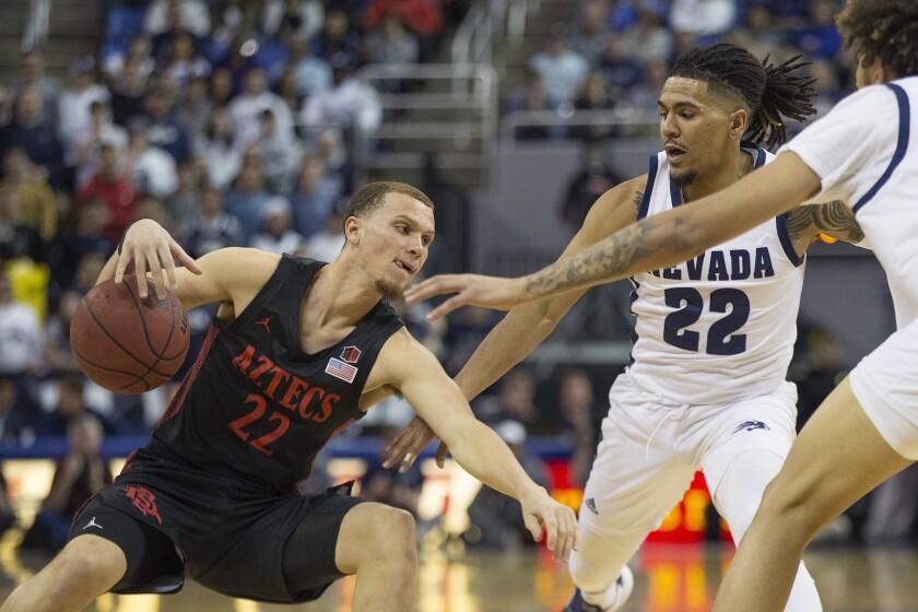 SDSU guard Malachi Flynn (22) drives against Nevada guard Jazz Johnson (22) in the Aztecs' 83-76 win in Reno, Nev.