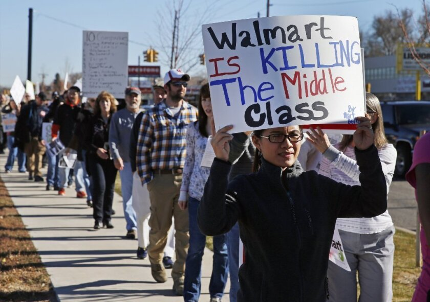 Protestors in Colorado in 2013 sought higher pay for Wal-Mart employees.