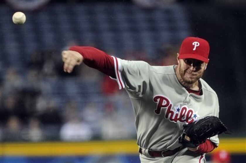 Philadelphia Phillies pitcher Roy Halladay works against the Atlanta Braves during the first inning of a baseball game on Wednesday, April, 3, 2013. (AP Photo/John Amis)