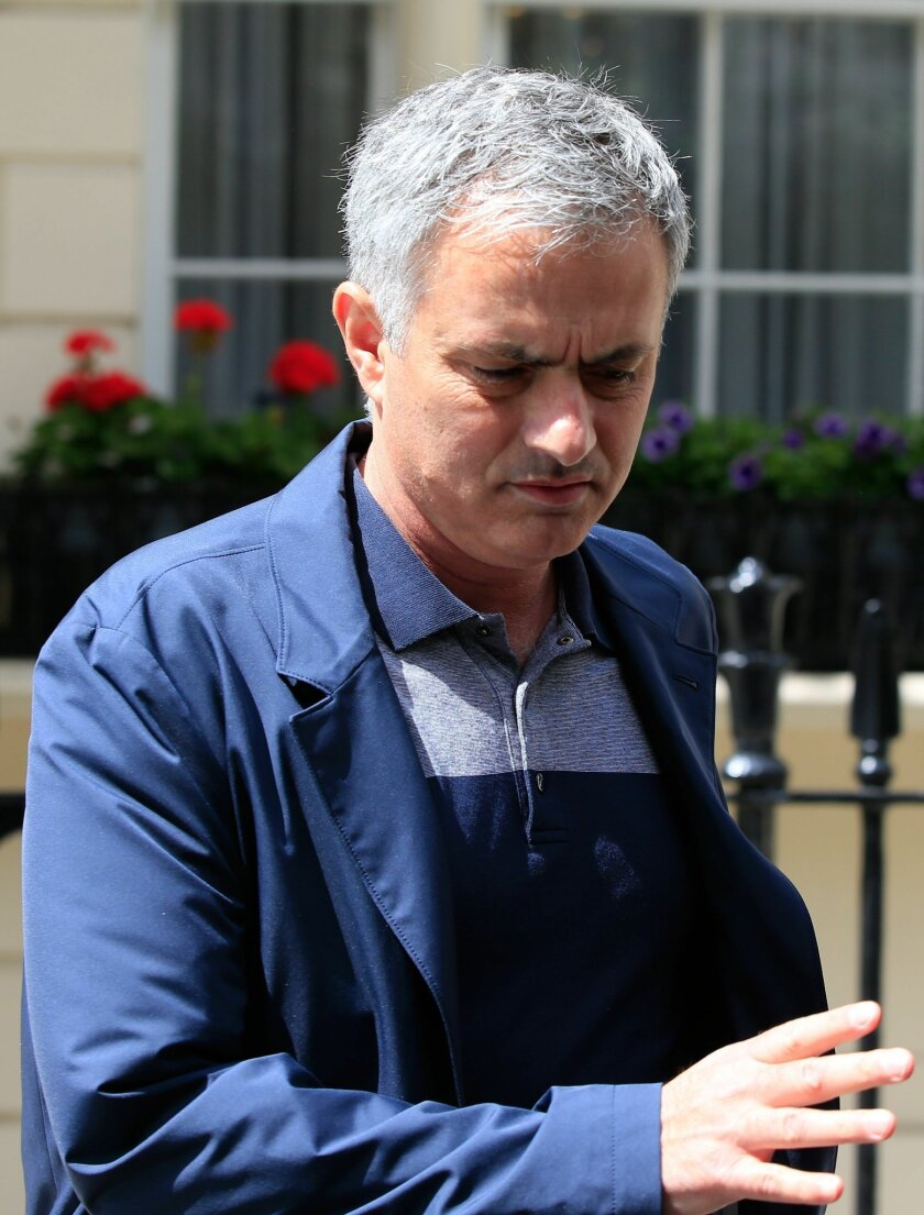 Jose Mourinho leaves his London home, Monday May 23, 2016. Manchester United has fired manager Louis van Gaal after two turbulent years at the English Premier League club, it was reported on Monday, May 23, 2016. Former Chelsea manager Jose Mourinho is expected to replace Van Gaal. (Jonathan Brady/PA via AP) UNITED KINGDOM OUT