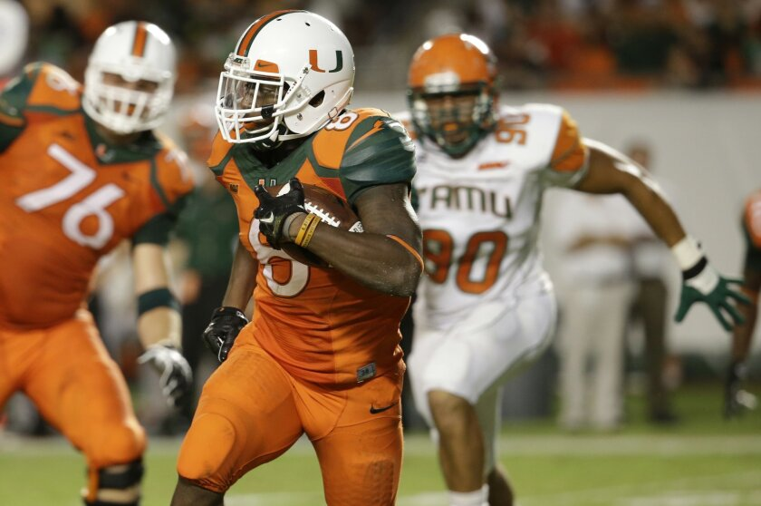 Miami running back Duke Johnson (8) runs for a first down in the first half of an NCAA football game against Florida A&M, Saturday, Sept. 6, 2014, in Miami Gardens, Fla. (AP Photo/Lynne Sladky)