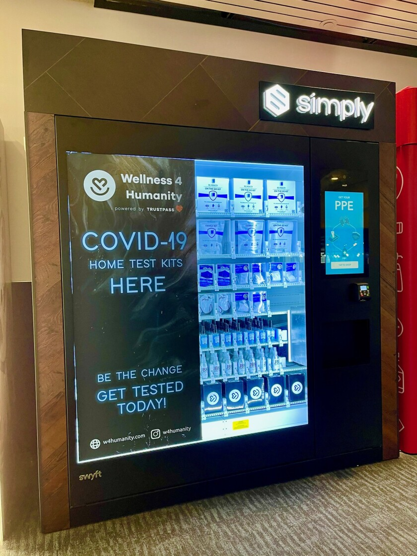 A vending machine at Oakland International Airport sells masks, sanitizer and COVID-19 test kits.