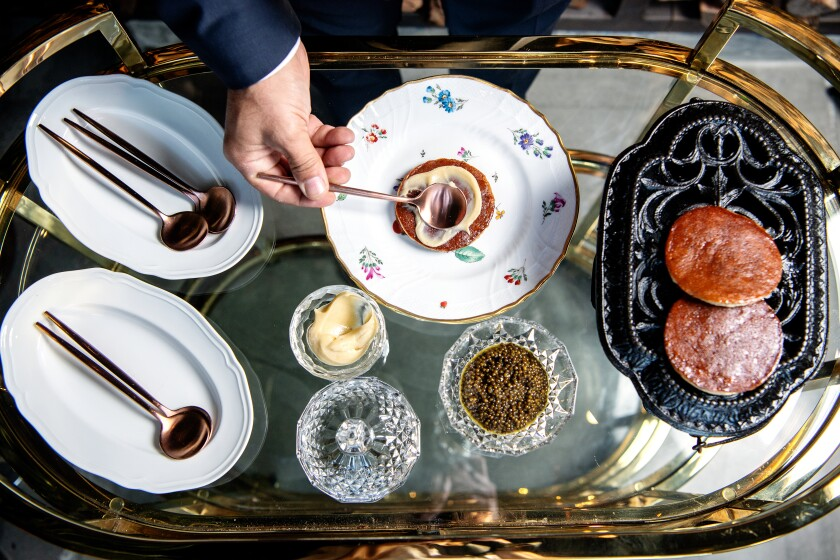 Caviar with banana pancake is assembled tableside at Angler