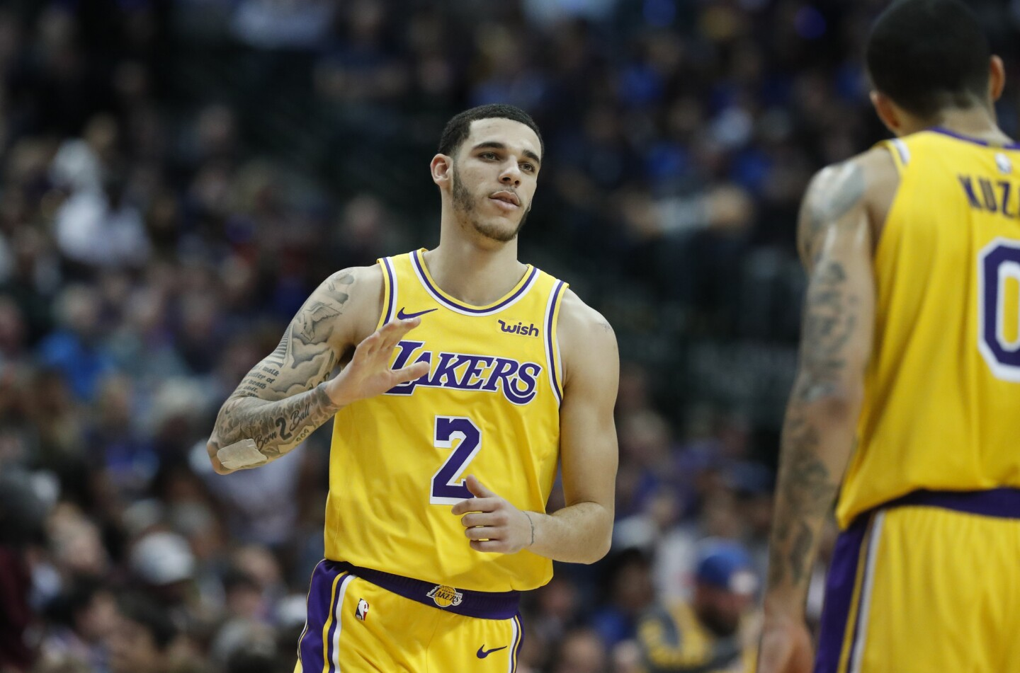 Los Angeles Lakers guard Lonzo Ball (2) and forward Kyle Kuzma (0) during the second half of an NBA basketball game against the Dallas Mavericks in Dallas, Monday, Jan. 7, 2019. (AP Photo/LM Otero)