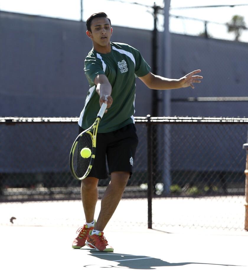 Costa Mesa High's Hritik Ronvelia hits against Estancia in a No. 2 singles set during an Orange Coas