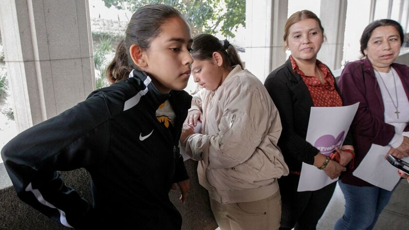 Fatima Avelica, left, with sister Yuleni, mother Norma and aunt Martina Avelica earlier this month at L.A. Superior Court to support her father, Romulo Avelica-Gonzalez, an immigrant who was detained by ICE agents as he drove her to school in Highland Park.
