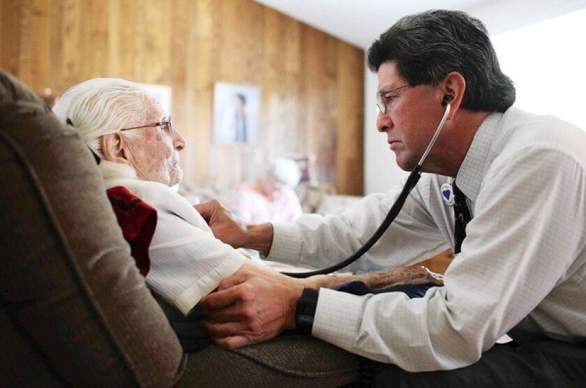 Dr. Gene Dorio checks up on Emma Luebke, 103, in her Santa Clarita home. Dorio, a geriatric physician, sees about 80% of his 300 patients in their homes and the remainder in the hospital.