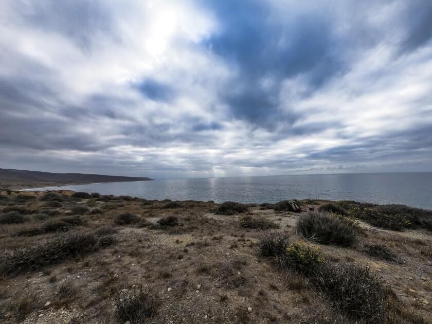 An uninhabited stretch of coastline under the clouds