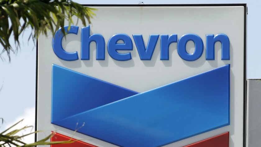 FILE- This Aug. 20, 2012, file photo, shows a Chevron sign in Miami. A Northern California jury orde