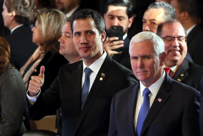 Venezuelan self-proclaimed acting president Juan Guaido (l.), stands next to US Vice President Mike Pence during a conference in Bogota on Monday, Feb. 25. EFE-EPA/Mauricio Dueñas Castañeda