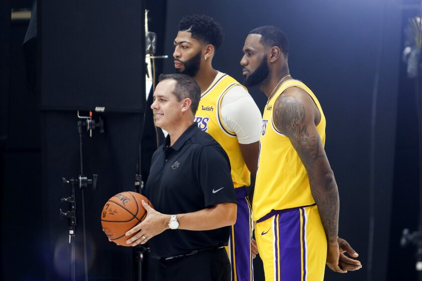 All-Stars LeBron James and Anthony Davis pose for a photo with Lakers coach Frank Vogel during media day on Sept. 27, 2019.
