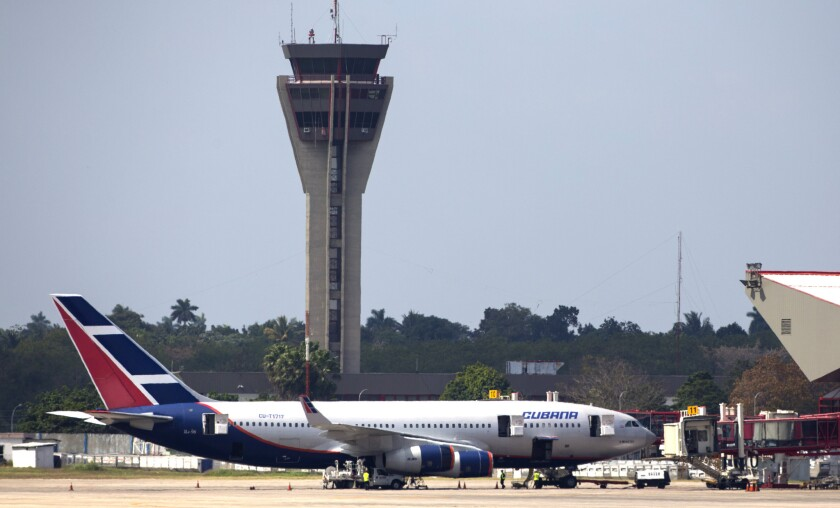 A Cubana Airlines aircraft is stationed at the international terminal of the Jose Marti Airport in Havana. Several U.S. carriers have applied for permission from the U.S. Department of Transportation to fly regular routes to Cuba.
