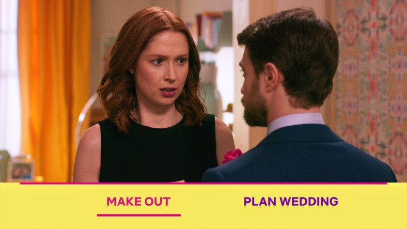 "Ellie Kemper and Daniel Radcliffe in ""Unbreakable Kimmy Schmidt: Kimmy vs. the Reverend"""