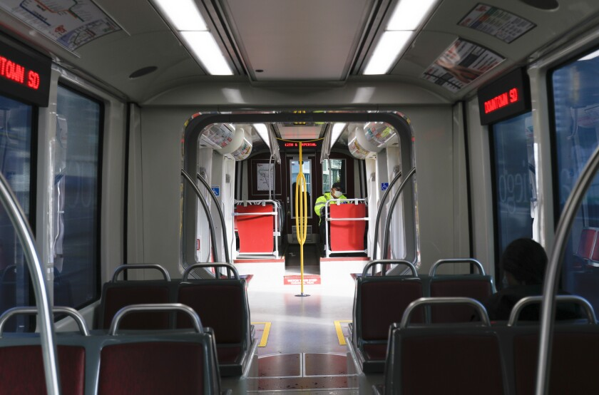 On Wednesday April 8, 2020, a near empty trolley train prepares to depart from the 12th and Imperial Transit Center in downtown, San Diego. With the current Coronavirus pandemic, passengers on the trolley and bus routes have declined.