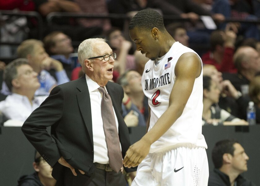 San Diego State vs Boise State Mens Basketball at Viejas Arena. SDSU Head Coach Steve Fisher has some words with Xavier Thames in the second half.
