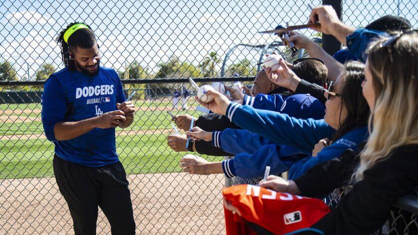 GLENDALE, AZ - FEBRUARY 19, 2019: Dodgers closing pitcher Kenley Jansen signs autographs during spr