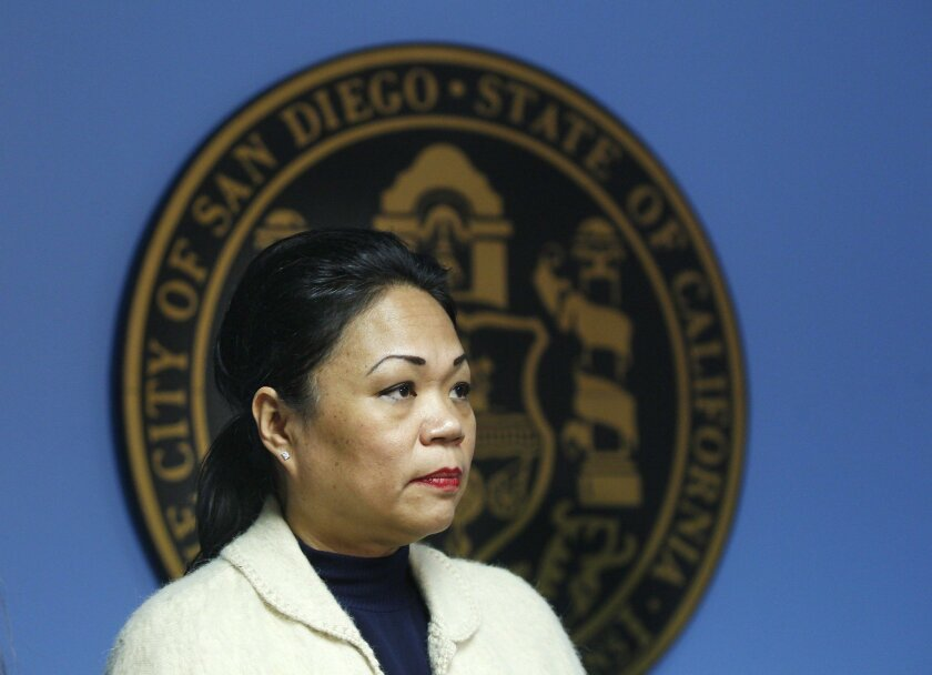 The city of San Diego has agreed to pay Benelia Santos-Hunter $667,000 to settle one of three unresolved sexual battery and harassment lawsuits against former Mayor Bob Filner. Santos-Hunter, who worked as the mayor's executive assistant, is shown here during a news conference.