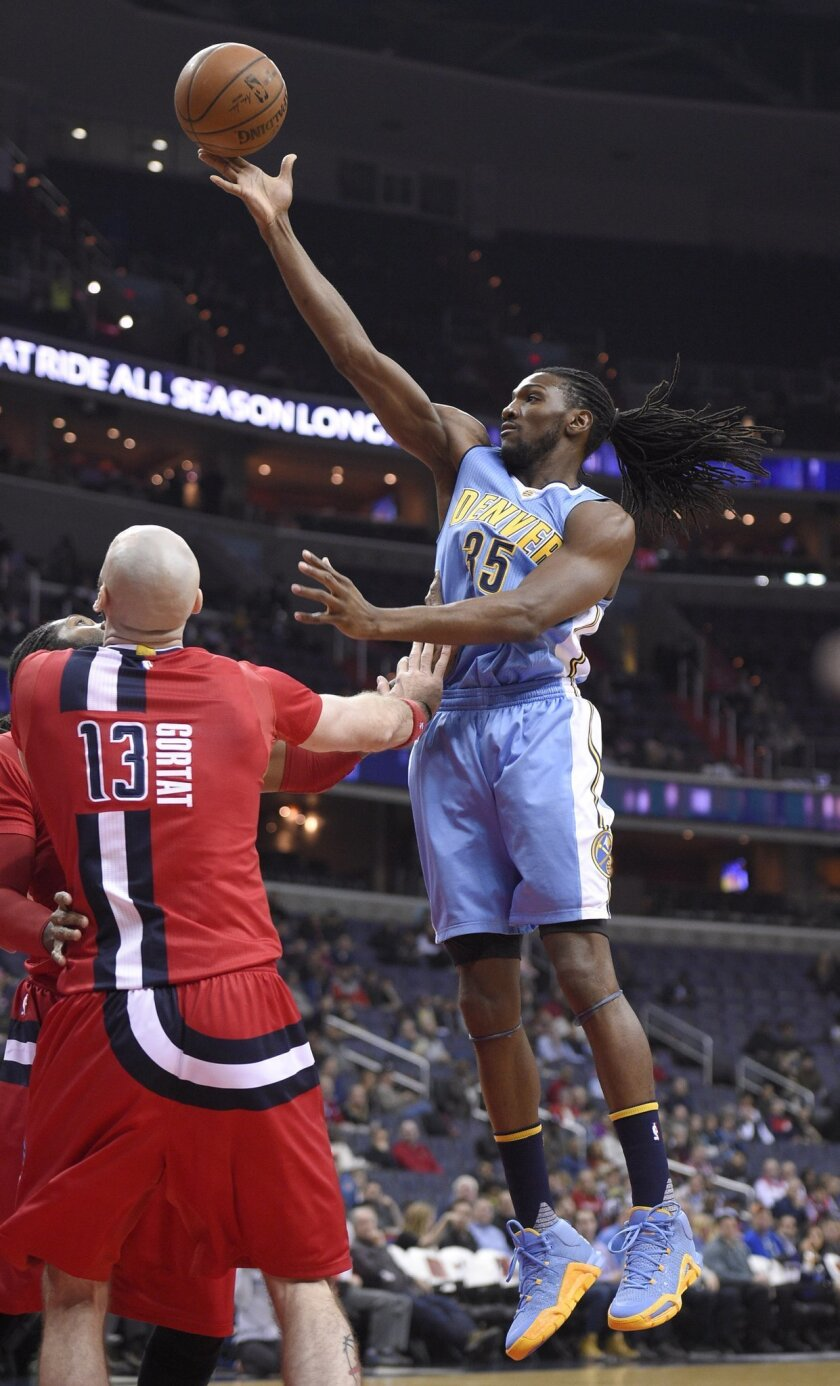 Denver Nuggets forward Kenneth Faried (35) goes to the basket against Washington Wizards center Marcin Gortat (13), of Poland, during the first half of an NBA basketball game Thursday, Jan. 28, 2016, in Washington. (AP Photo/Nick Wass)