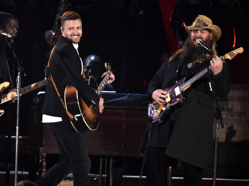 Justin Timberlake, left, and Chris Stapleton perform at the 49th annual CMA Awards at the Bridgestone Arena on Wednesday, Nov. 4, 2015, in Nashville, Tenn. (Photo by Chris Pizzello/Invision/AP)