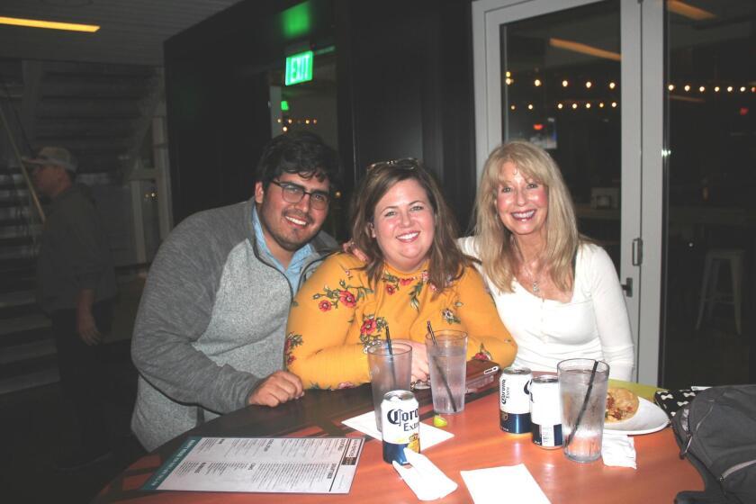 Carlos Vanegas-Moran, Sydney Basilonia and Suzanna Esparza share their table, their smiles, their night and their friendship at Mavericks.