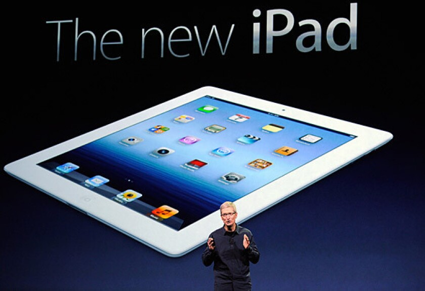 Apple Chief Executive Tim Cook introduces the new iPad -- featuring a sharper screen and a faster processor -- during an event in San Francisco. Apple says the new iPad will hit stores March 16.
