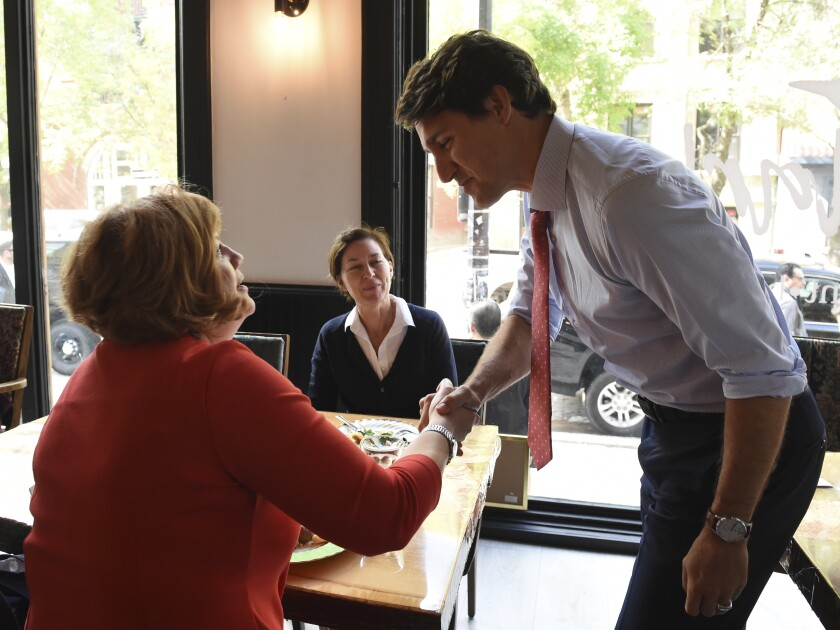 Canadian Prime Minister speaks with people in a cafe in Winnipeg