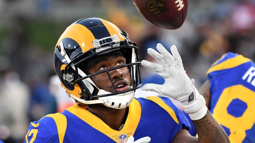 Rams receiver Brandin Cooks plays with a football on the sidelines during a game last season against the 49ers at the Coliseum.
