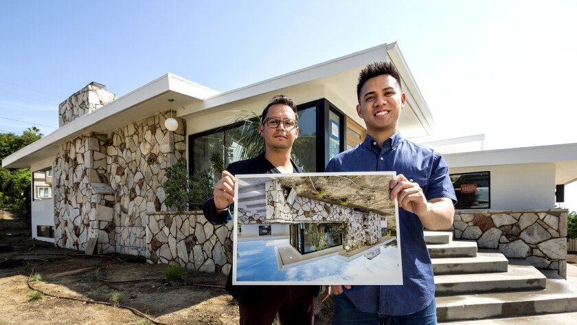 Thomas Bayles, left and his business partner, Alan Quach, at one of the properties they're renovating.
