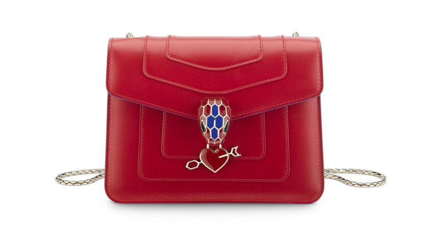 Bulgari: Bulgari's luxe Serpenti Forever Electro Love calf leather handbag in red Carmine Jasper. $
