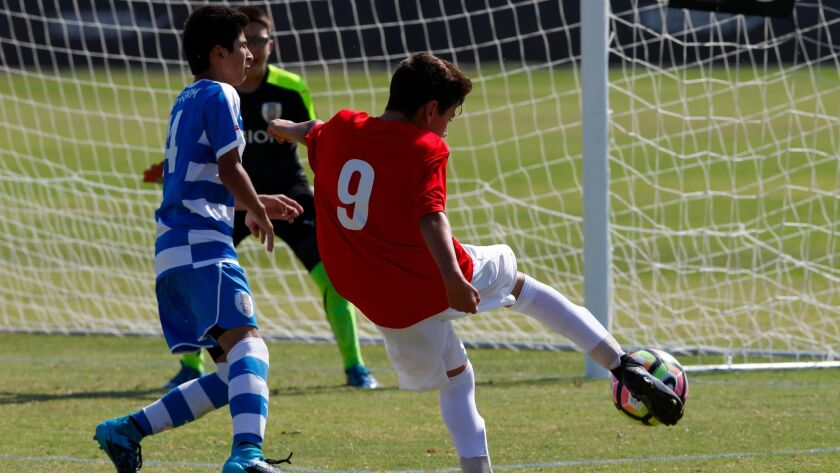 Nomads Dean Dickow gets his shot off pass Albion defender, Jorge Rivas but was saved by the keeper during their match up at the Surf Cup played in Del Mar.