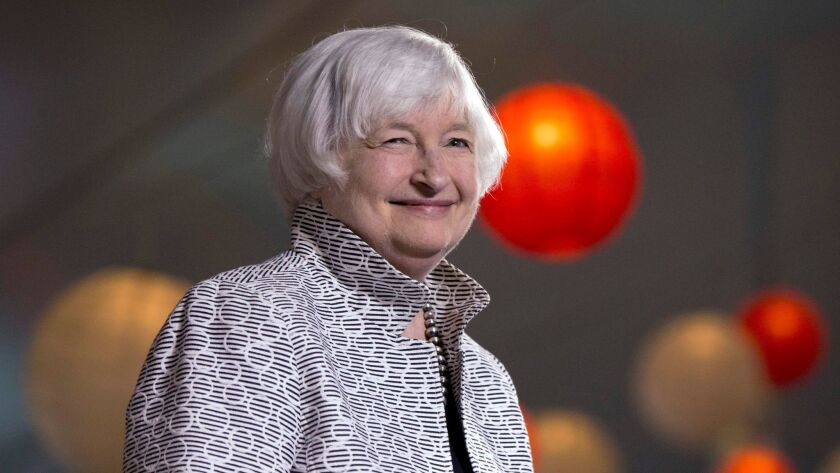 Federal Reserve Chair Janet Yellen smiles before giving a speech during a conference at Brown Univer