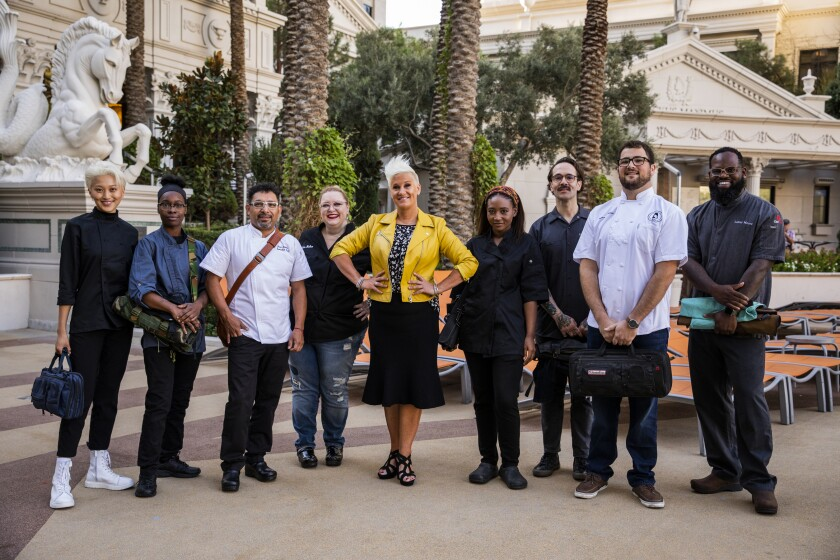 """Vegas Chef Prizefight"" host Anne Burrell, center, with competitors Janey Lyu, left, Roshara Sanders, Juan Zepeda, Julia Helton, Brittney Brown, Jeff Kraus, Jeffrey Compton and Lamar Moore."