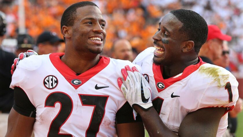 Georgia tailbacks Nick Chubb, left, and Sony Michel decided to return for their senior season. That decision helped catapult Georgia into the national championship game against Alabama.