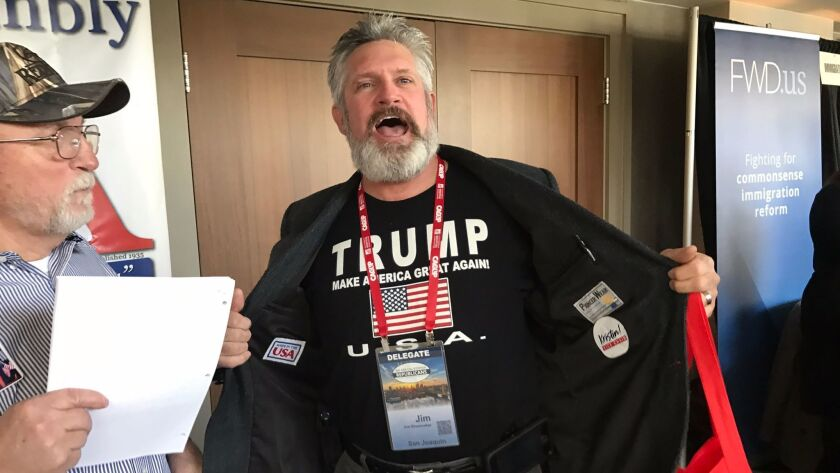 Jim Shoemaker, a Republican delegate from San Joaquin County, displays his support for President Trump at the California Republican Party convention in Sacramento on Saturday.