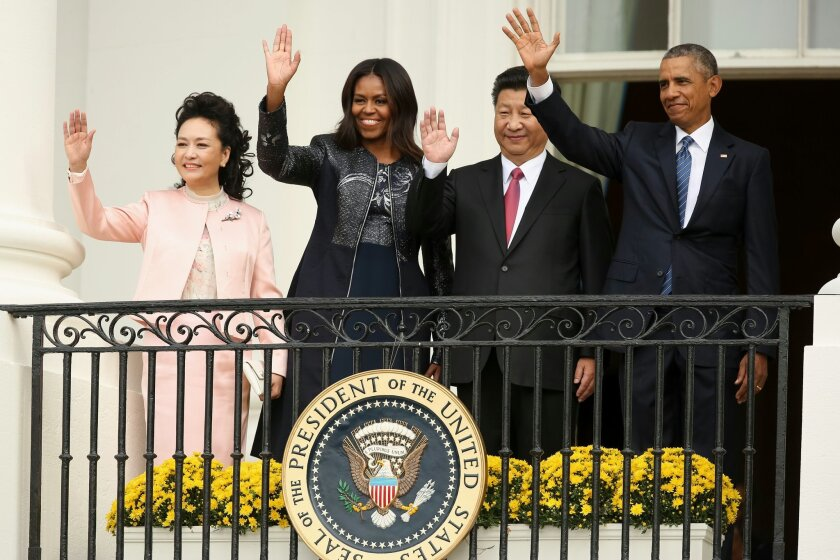 President Barack Obama, Chinese President Xi Jinping, first lady Michelle Obama and Chinese first lady Madame Peng Liyuan wave from the Truman Balcony of the White House in Washington, Friday, Sept. 25, 2015, after a state arrival ceremony for the Chinese president on the South Lawn. (AP Photo/Andrew Harnik)