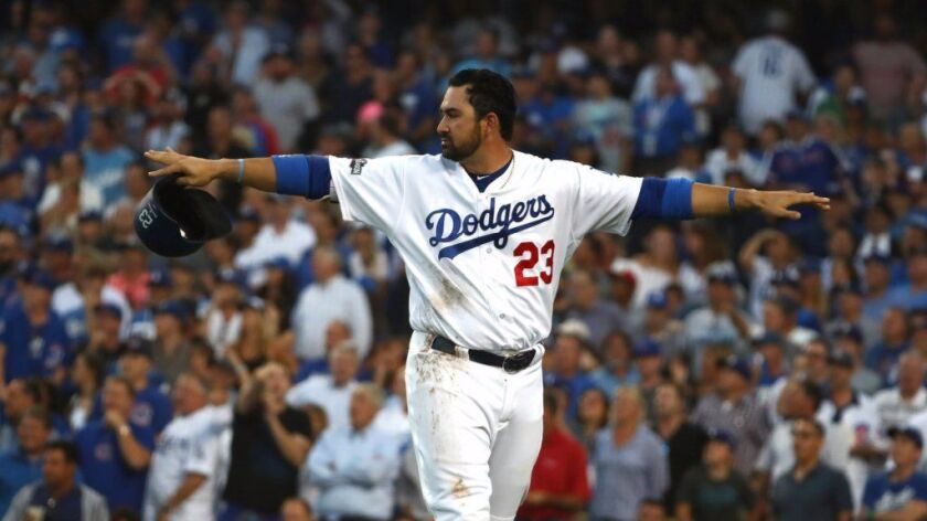Dodgers first baseman Adrian Gonzalez signals that he's safe after getting tagged out at home plate by Cubs catcher Willson Contreras during Game 4 of the National League Championship Series on Oct. 19.