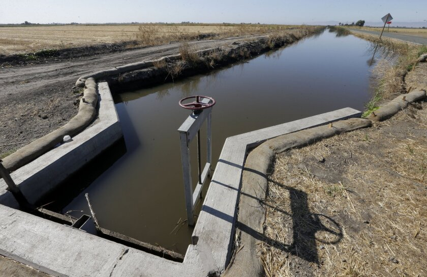 Water flows down a canal near Byron, Calif. A new poll finds Californians more concerned about the drought than any other issue.