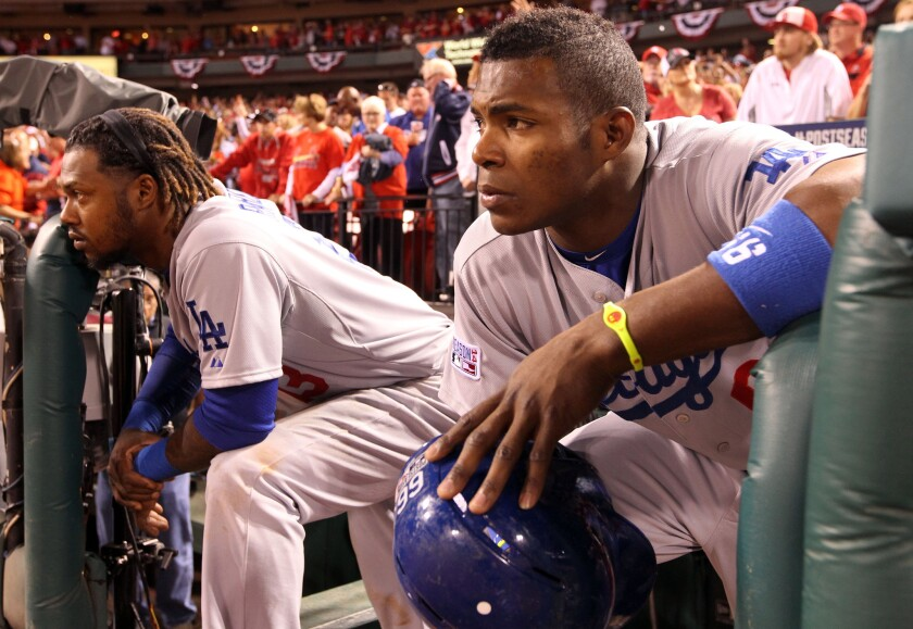 Dodgers outfielder Yasiel Puig watches the St. Louis Cardinals celebrate after winning the National League Division Series on Tuesday.