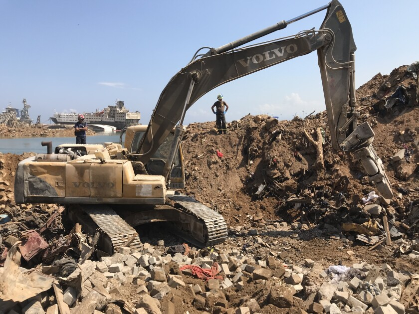 An excavator sifts through the rubble in Beirut's ravaged port.