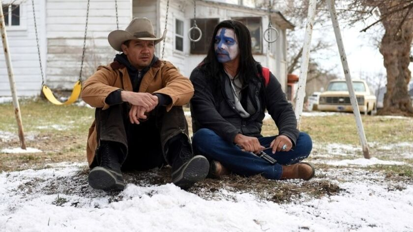 """Jeremy Renner, left, and Gil Birmingham appear in a scene from """"Wind River."""""""