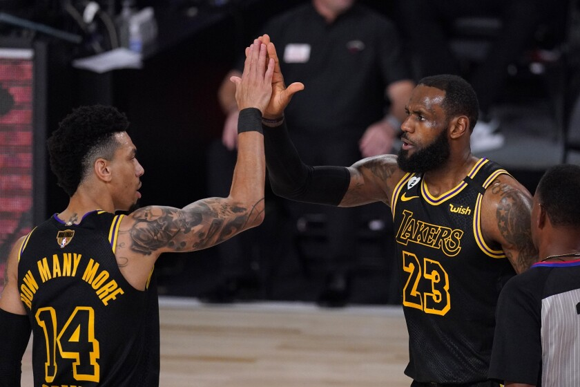 Los Angeles Lakers' Danny Green (14) and LeBron James  celebrate a basket by James.