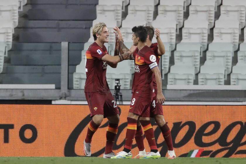 Roma's Diego Perotti, right, celebrates after scoring his side's third goal with his teammate Roma's Nicolo Zaniolo during a Serie A soccer match between Juventus and Roma, at the Allianz stadium in Turin, Italy, Saturday, Aug.1, 2020. (AP Photo/Luca Bruno)