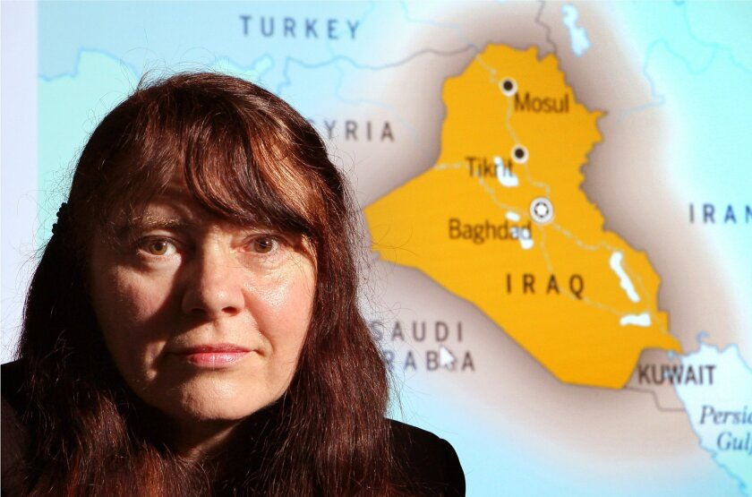 Portrait of Dr. Beatice Golomb, UCSD Medical School professor and researcher, with a map of Iraq where she's studied Gulf War Syndrome.