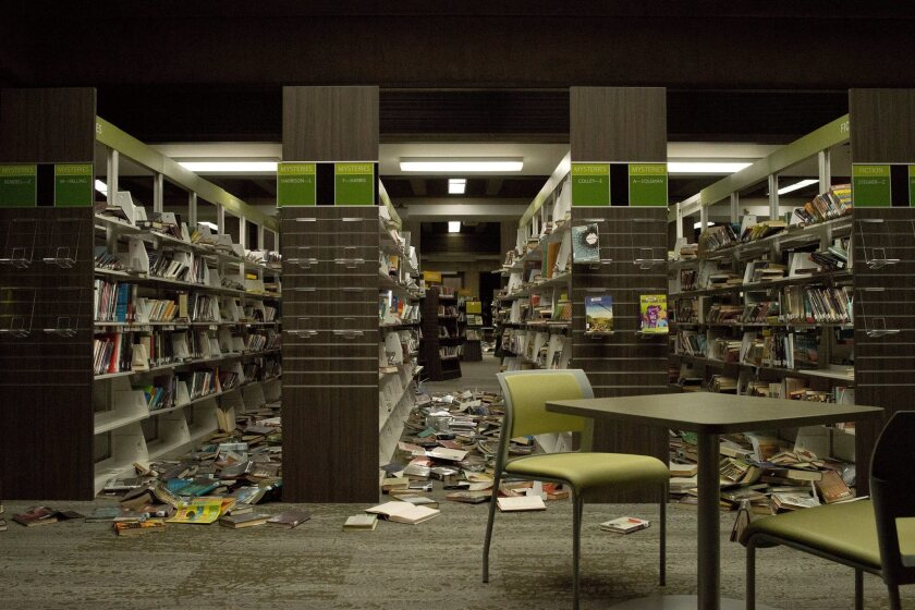 Books were thrown from shelves at the Napa Public Library after a magnitude 6.0. earthquake hit the area Sunday morning.