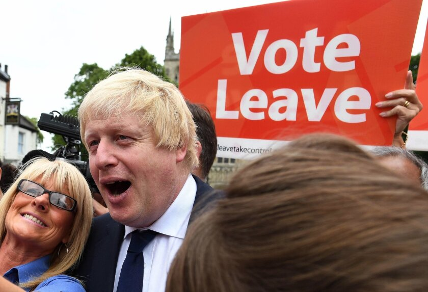 FILE In this Wednesday, June 22, 2016 file photo, advocate to exit Europe Boris Johnson poses for a selfie photo with voters during a whistle stop tour of the country on the final day of campaigning before Thursday's EU referendum vote, in Selby, north England. (Andrew Parsons / PA via AP, File) UN