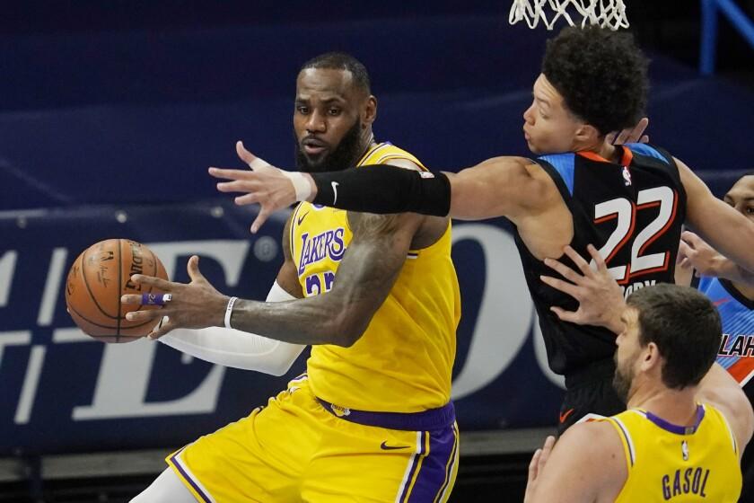Lakers forward LeBron James moves around Oklahoma City Thunder forward Isaiah Roby.